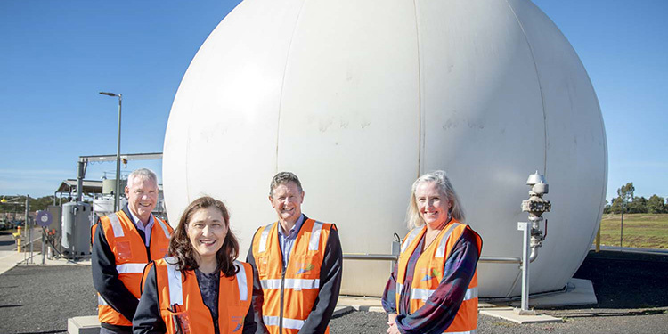 Standing in front of Western Water's biodome where the biogas is stored before being converted to electricity is: Steve McGhie, Member for Melton; Lily D'Ambrosio, Minister for Energy, Environment and Climate Change; Jeff Rigby, Managing Director of Western Water; and Claire Ferres Miles, CEO of Sustainability Victoria.